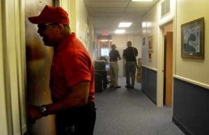 man trying to open door during an active shooter training for business program